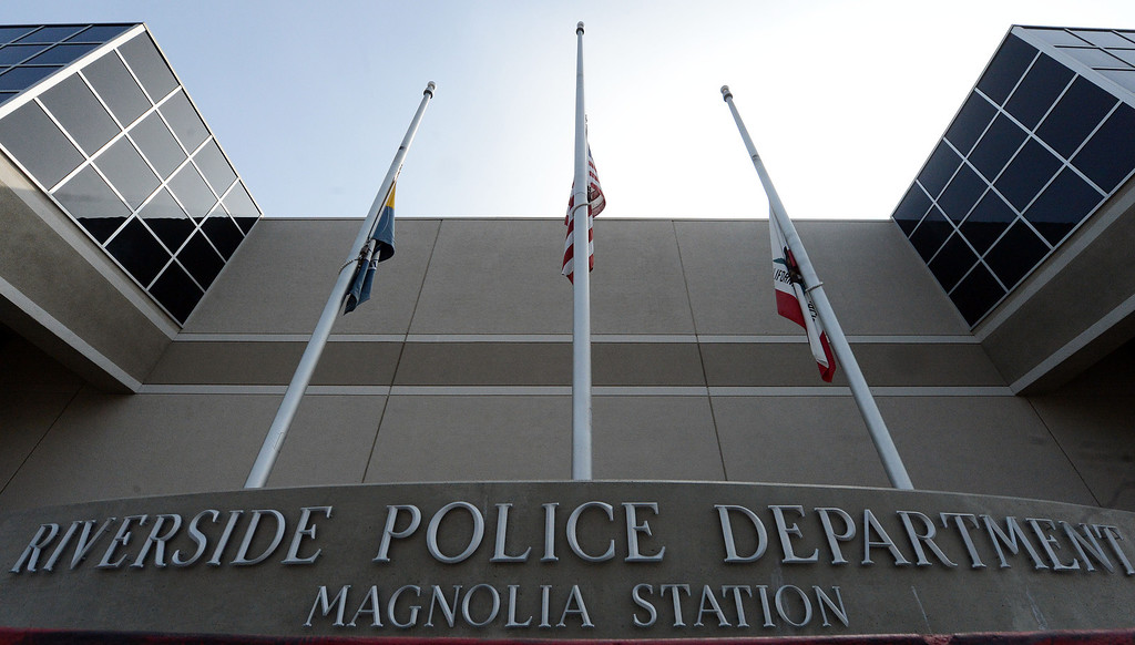 Description of . Flags fly at half staff outside the Riverside police station Thursday February 7, 2013. Two Riverside police officers were shot early Thursday morning, one fatally, with the second in critical condition, both were believed to have been shot in a ambush by ex LAPD officer Christopher Jordan Dorner who is still at large. Dorner is also the suspect in the murder of an Irvine couple on Sunday. (Staff photo by Will Lester/Inland Valley Daily Bulletin)