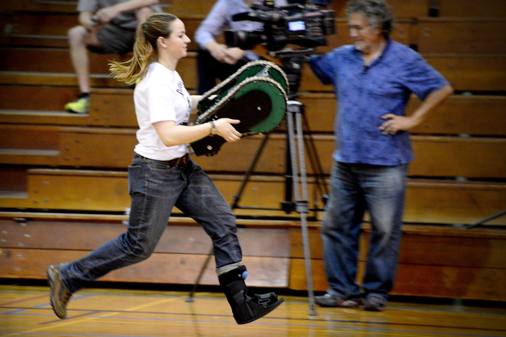 Description of . Avengers Erin Evans brings her team's vehicle to a starting position as teams of mechanical engineering Caltech students compete in the annual ME72 Engineering Design Contest at the Pasadena campus Tuesday, March 11, 2014. The goal in