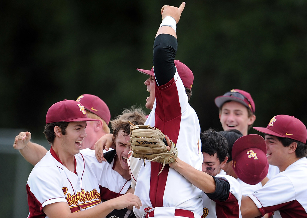 Description of . La Canada's Anthony Mizrahi, center, celebrates with teammates after defeating San Marino 3-2 to win the Rio Hondo League during a prep baseball game at La Canada High School on Wednesday, March 8, 2013 in La Canada, Calif.  (Keith Birmingham Pasadena Star-News)