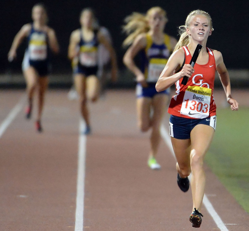 Description of . Great Oak's Haley Dorris runs the final leg of the 4x1600 Meter Relay Invitational during the Arcadia Invitational track and field meet at Arcadia High School in Arcadia, Calif., on Friday, April 11, 2014. Great Oak won the race.  (Keith Birmingham Pasadena Star-News)