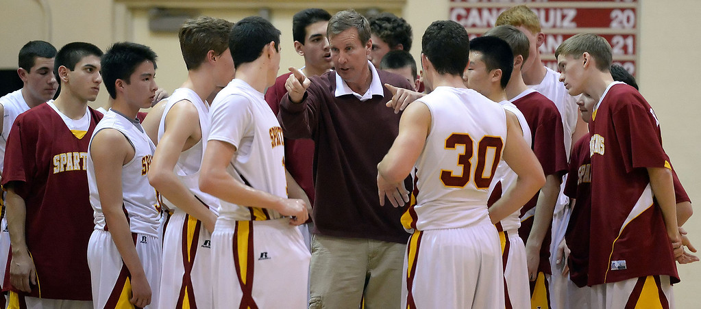 Description of . La Canada head coach Tom Hofman during a time-out in the first half as they defeated La Salle 73-62 for coach Hofman's 600th win during a prep basketball game at La Canada High School in La Canada, Calif., on Friday, Jan. 10, 2014. Hofman record is 600 wins and 186 losses since becoming varsity head coach in the 1986-87 season. (Keith Birmingham Pasadena Star-News)