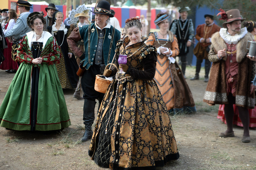 Description of . Locals dress in period costumes on opening day of the Renaissance Pleasure Faire at Santa Fe Dam Recreation Area in Irwindale, Calif., on Saturday, April 5, 2014. 