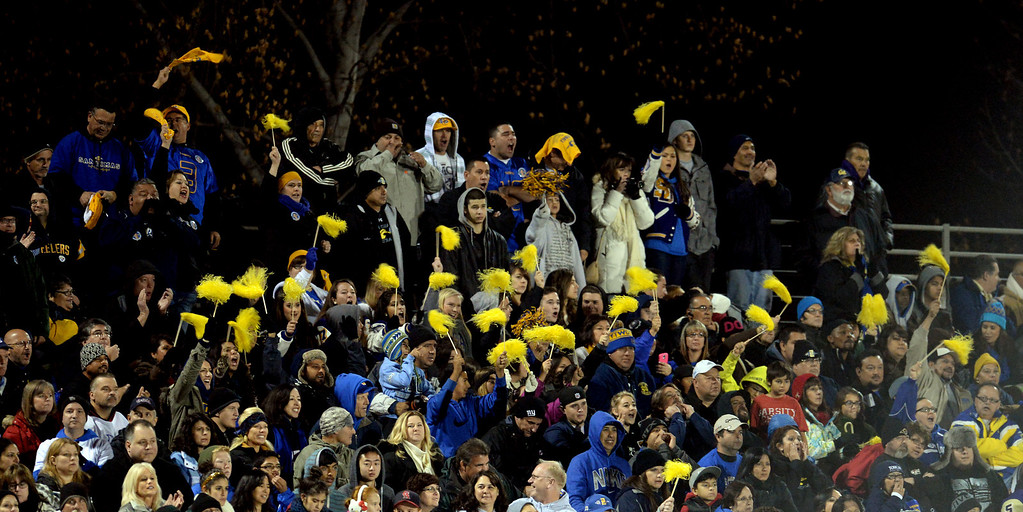 Description of . San Dimas fans react after a touchdown against Paraclete in the first half of a CIF-SS Mid-Valley Division championship football game at San Dimas High School in San Dimas, Calif., on Friday, Dec. 6, 2013.   (Keith Birmingham Pasadena Star-News)