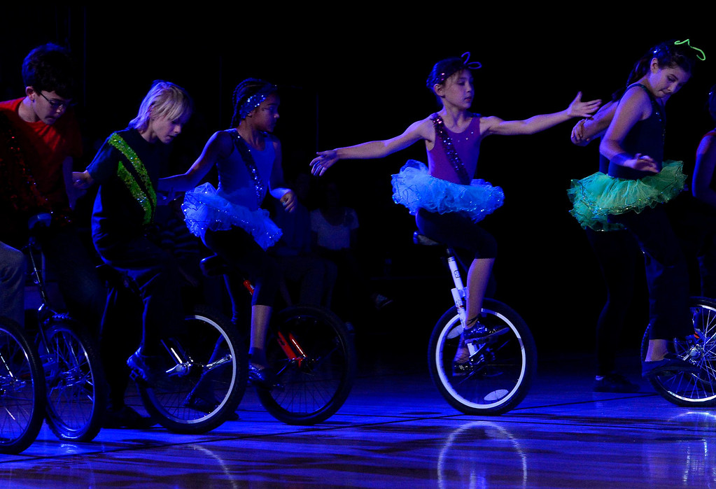 Description of . Children ride unicycles during the Great Y Circus in Redlands May 3, 2013.  GABRIEL LUIS ACOSTA/STAFF PHOTOGRAPHER.