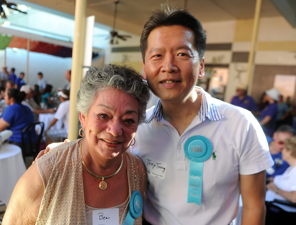 Description of . Diamond Bar community heroes Bea McMillian, left, with Tony Yi Torng, pose for a photograph prior to the community parade during the 91st Annual L.A. County Fair in Pomona, Calif. on Thursday, Sept. 5, 2013.   (Photo by Keith Birmingham/Pasadena Star-News)
