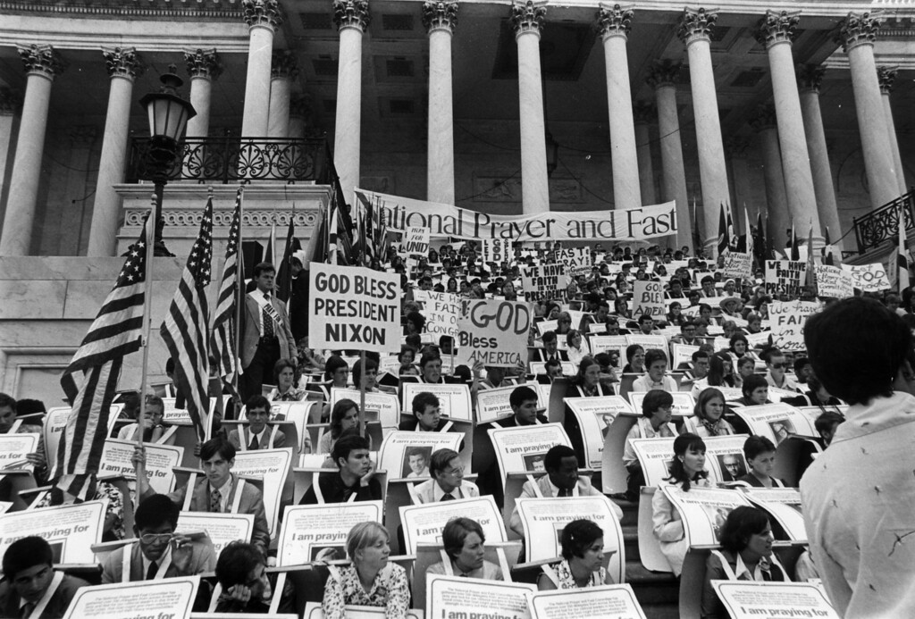 Description of . 29th July 1974:  A prayer vigil in support of Republican President Richard Nixon during the Watergate crisis.  (Photo by Keystone/Getty Images)