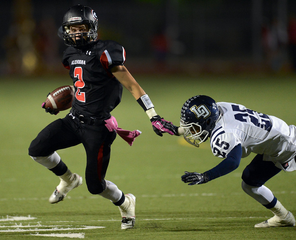 Description of . Glendora's Briton Noskoff (2) runs past Los Osos' Vincent Wilkes (25) for a first down in the first half of a prep football game at Citrus College in Glendora, Calif., on Thursday, Oct. 31, 2013.    (Keith Birmingham Pasadena Star-News)