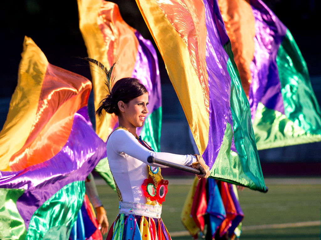Description of . Flag twirlers of the Banda de Musico Herberto Lopez Colegio of Panama perform during the Pasadena Tournament of Roses Bandfest I at Pasadena City College Dec. 29, 2013.   (Staff photo by Leo Jarzomb/Pasadena Star-News)