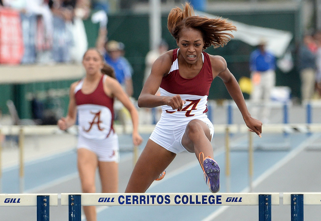Description of . Alemany's Skylin Harbin wins the division 4 300 meter low hurdles during the CIF Southern Section track and final Championships at Cerritos College in Norwalk, Calif., Saturday, May 24, 2014. 