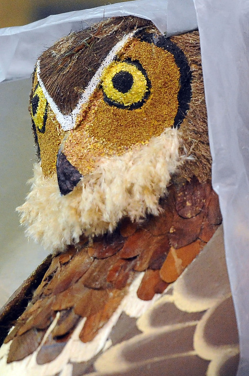 Description of . An owl atop the Kiwanis float during the final stages of preparation for the 2014 Rose Parade as a variety of seeds, bark, fruits and vegetables, grasses and of course, flowers are being applied to the floats by experienced professionals as well as hard working volunteers at the Rosemont Pavilion in Pasadena, Calif., on Saturday, Dec. 28, 2013.     (Keith Birmingham Pasadena Star-News)