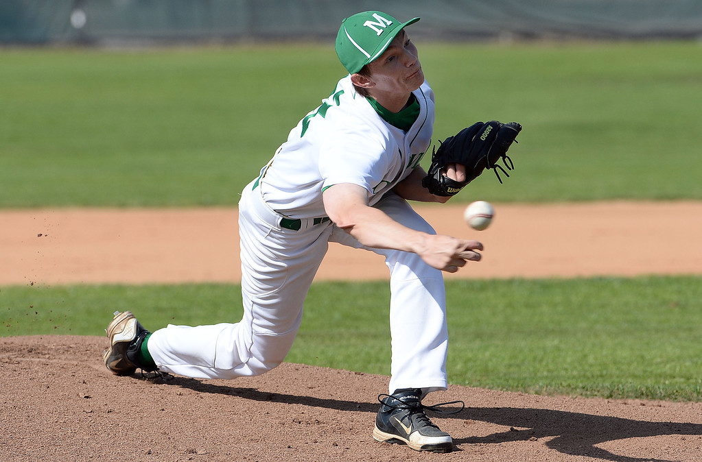 Description of . Monrovia starting pitcher Brian McConnell throws to the plate against Alhambra in the first inning of the Arcadia Elk Baseball Tournament at Monrovia High School in Monrovia, Calif., on Thursday, March 13, 2014. Monrovia won 2-0.  (Keith Birmingham Pasadena Star-News)