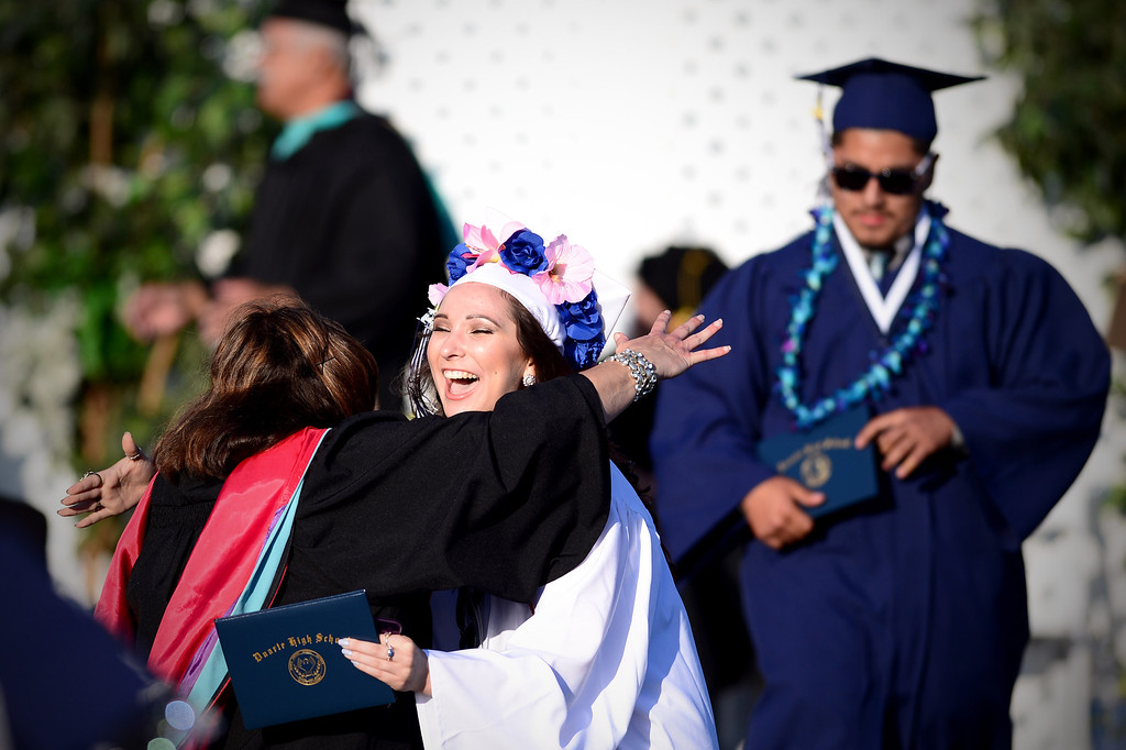 Description of . Sophia Camp hugs faculty after receiving her diploma during Duarte High School's commencement ceremony Thursday night,  June 12, 2014 at the Duarte school. (Photo by Sarah Reingewirtz/Pasadena Star-News)