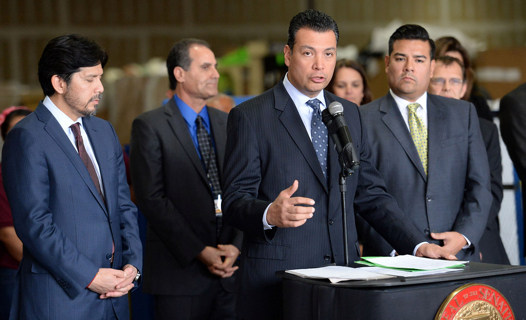 Description of . Sen. Alex Padilla, D-Pacoima, center, along with Senator Kevin de Leon, left, D-Los Angeles and Senator Ricardo Lara, right, D-Huntington Park/ Long Beach announces the support for legislation to ban single use plastic bags during a press conference at Command Packaging in Vernon, Calif., on Friday, Jan. 24, 2014. (Keith Birmingham Pasadena Star-News)