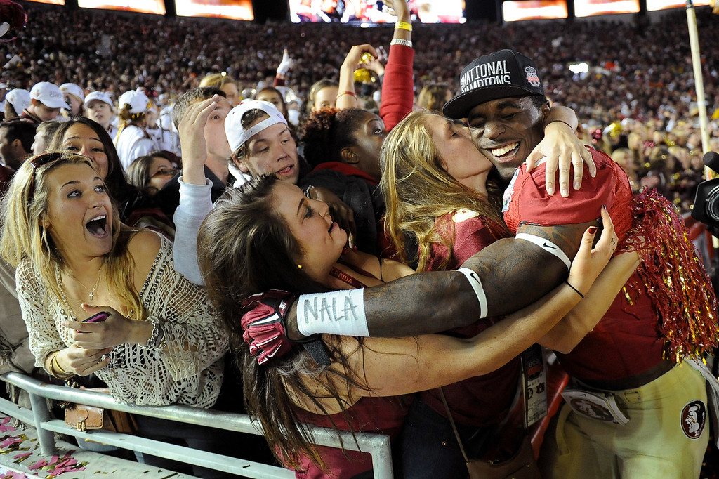 Description of . Florida State's James Wilder Jr. is congratulated by fans following the 2014 Vizio BCS National Championship January 6, 2014 in Pasadena CA.  Florida State won the game 34-31.(Andy Holzman/Los Angeles Daily News)