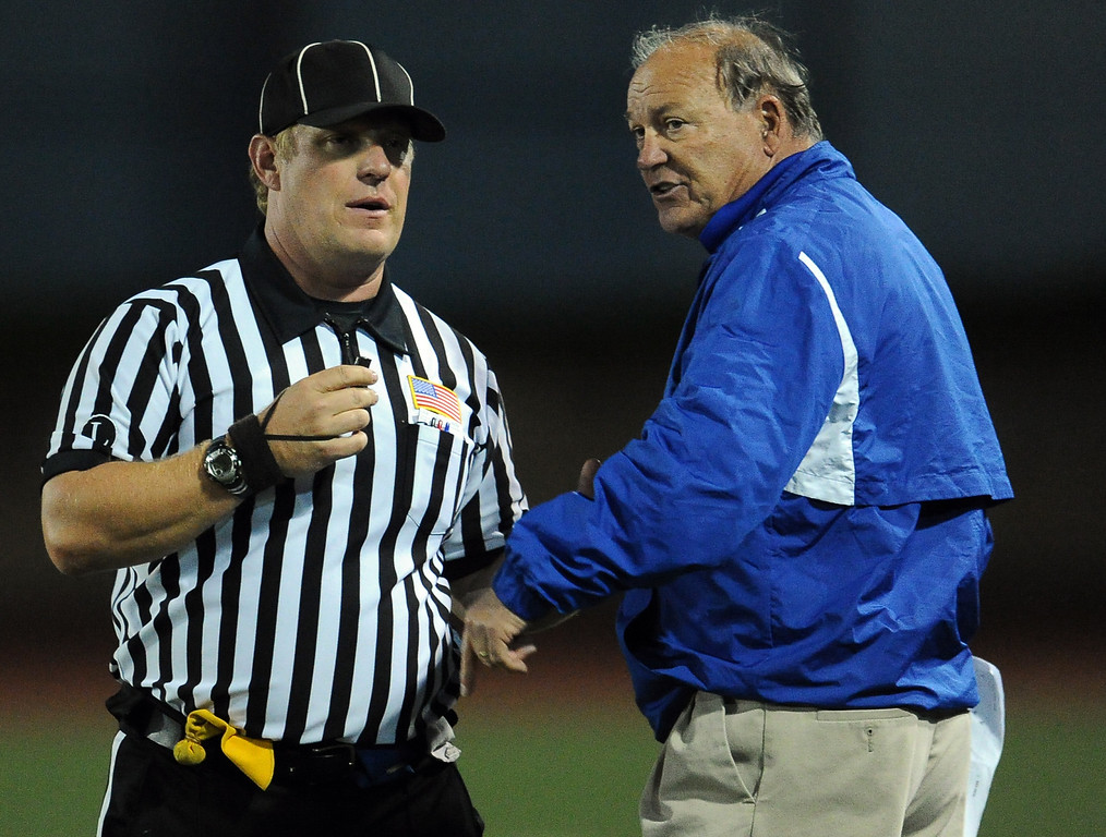 Description of . San Marino head coach Mike Hobbie talks with an official in the first half of a prep football game against Monrovia at Monrovia High School in Monrovia, Calif., on Friday, Nov. 8, 2013. 