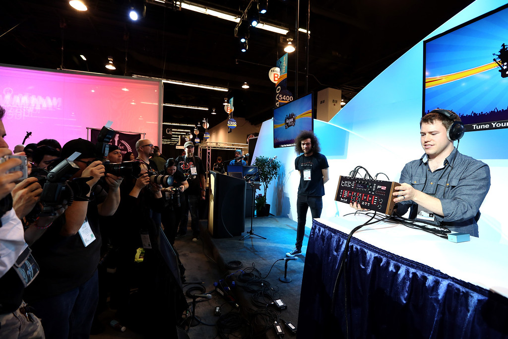 Description of . ANAHEIM, CA - JANUARY 22:  Keyboardist Peter Dyer presents Dave Smith Instruments at the 2014 National Association of Music Merchants show media preview day at the Anaheim Convention Center on January 22, 2014 in Anaheim, California.  (Photo by Jesse Grant/Getty Images for NAMM)