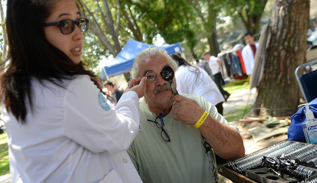 "Description of . Katie Allen, left, gives an eye exam to US Army veteran, Jerry Bostock during ""Heroes in the Shadows"" San Gabriel Valley Homeless Stand Down, A three day event presented by The Vet Hunters Project and The SGV Veterans Employment Committee aims to combat Homelessness by providing on site assistance, services and resources to those in need at Whittier Narrows Recreation Park in South El Monte, Calif., on Saturday, April 5, 2014.  (Keith Birmingham Pasadena Star-News)"