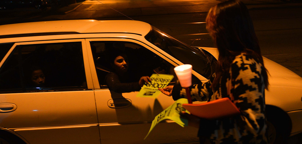 Description of . Friends, family and supporters came out in folds Monday night to hold a candlelight vigil at the San Bernardino County Sheriff's Highland station in protest to the Jan. 18 shooting of 16-year-old Joshua Alvarez by deputies. LaFonzo Carter/Staff Photographer