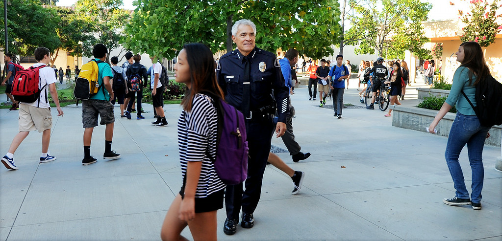 Description of . South Pasadena Police Chief Arthur Miller on South Pasadena High School campus on first day back to school Thursday, August 21, 2014. This the the campus where a 16- and 17-year-old boy allegedly planned a mass shooting to kill three staff members and as many students as possible, Police Chief Arthur Miller said. The Los Angeles County District Attorney's Office on Wednesday charged both boys with one count of making criminal threats. The D.A. has not charged the teens for conspiracy to commit a mass shooting, just a shooting. (Photo by Walt Mancini/Pasadena Star-News)