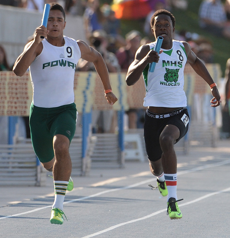 Description of . Monrovia's Cravon Gillespie, right, runs the final leg of the 4x100 meter relay during the CIF California State Track & Field Championships at Veteran's Memorial Stadium on the campus of Buchanan High School in Clovis, Calif., on Saturday, June 7, 2014. 
