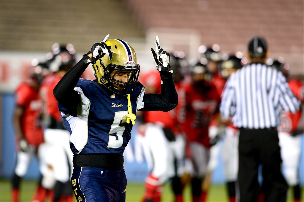 Description of . Daniels Cervantes (5) comes off the field after making the first touchdown of the annual Turkey Tussle against Pasadena Friday night, November 8, 2013 at the Rose Bowl in Pasadena. (Photo by Sarah Reingewirtz/Pasadena Star-News)