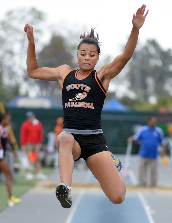 Description of . South Pasadena's Jazmin Jackmon competes in the Division 3 long jump during the CIF Southern Section track and final Championships at Cerritos College in Norwalk, Calif., Saturday, May 24, 2014. 