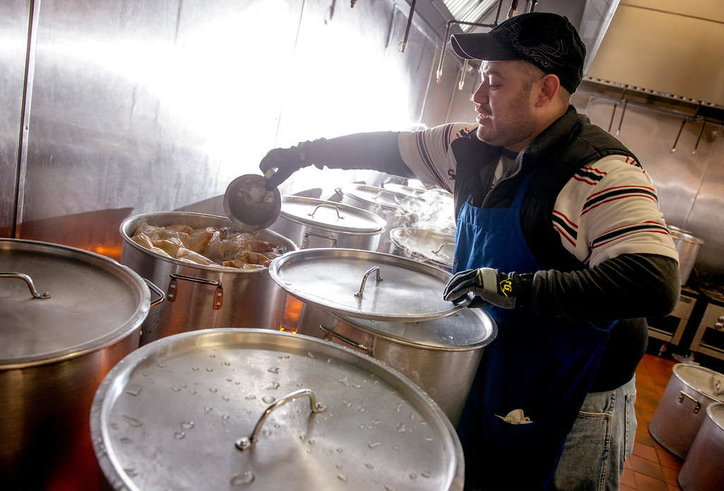 Description of . Raul Campos adds water to cooking pots at Tamales Lilianas where thousands of tamales are sold over the Christmas season at their East Los Angeles restaurant located at 4629 East Cesar E. Chavez Ave. Dec. 23, 2013.   (Staff photo by Leo Jarzomb/San Gabriel Valley Tribune)