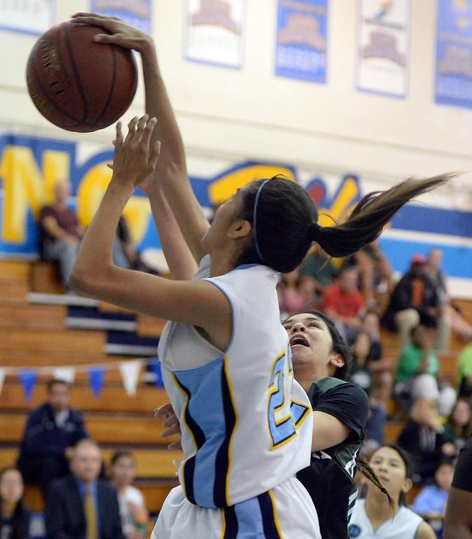 Description of . Walnut's Paulina Ochoa (22) blocks the shot by Bonita's Ariana Abo (C) in the first half of a prep basketball game at Walnut High School in Walnut, Calif., on Wednesday, Jan. 15, 2014. Bonita won 60-50. (Keith Birmingham Pasadena Star-News)