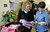 Brenda Jones shows wraps to Liz Barnett. Jones created her own open-in-the-front wrap when she was undergoing treatment for breast cancer, crafting an option to the hospital gown, utilizing soft and colorful flannel fabrics. Fellow patients loved them and her nonprofit Hug Wraps was born. Jones visited Providence Saint Joseph Medical Centers Roy and Patricia Disney Family Cancer Center and gave patients free wraps. Burbank, CA 2/22/2013(John McCoy/Staff Photographer)