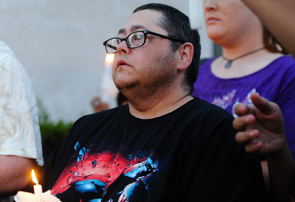 Description of . Finn Indovina, 49, of Riverside, speaks during a press conference for murder victim Domonique Newburn, a Fontana transgender who was found dead on Tuesday, as friends and LGBT supporters gather outside Newburn's residence in Fontana on Wednesday, Aug. 21, 2013. Police have not made an arrest in the case, but say a man seen leaving Newburn's home in a Mercedes may be the suspect in the killing. The vehicle, which was found at Perris Hill Park Wednesday in San Bernardino, is believed to belong to Newburn. (Rachel Luna / Staff Photographer)