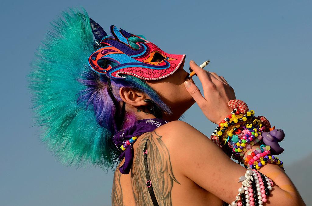 Description of . Ani Yegiazaryan, 21, of Running Springs, dresses as a Pegacorn during Insomniac's Beyond Wonderland rave at San Manuel Amphitheater in San Bernardino March 16, 2013.  (Photo by Gabriel Luis Acosta/The Sun)