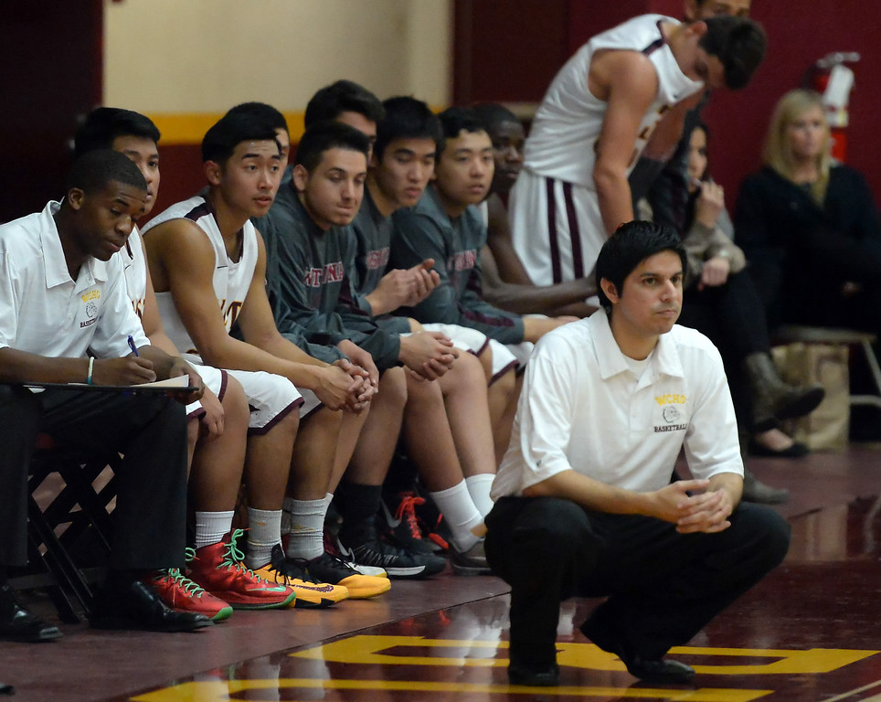 Description of . West Covina head coach Manuel Lopez in the first half of a prep basketball game against Diamond Ranch at West Covina High School in West Covina, Calif., on Wednesday, Jan. 8, 2014. (Keith Birmingham Pasadena Star-News)