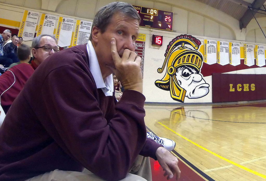 Description of . La Canada head coach Tom Hofman looks down court in the second quarter as he would win his 600th game after defeating La Salle 73-62 during a prep basketball game at La Canada High School in La Canada, Calif., on Friday, Jan. 10, 2014. Hofman record is 600 wins and 186 losses since becoming varsity head coach in the 1986-87 season. (Keith Birmingham Pasadena Star-News)