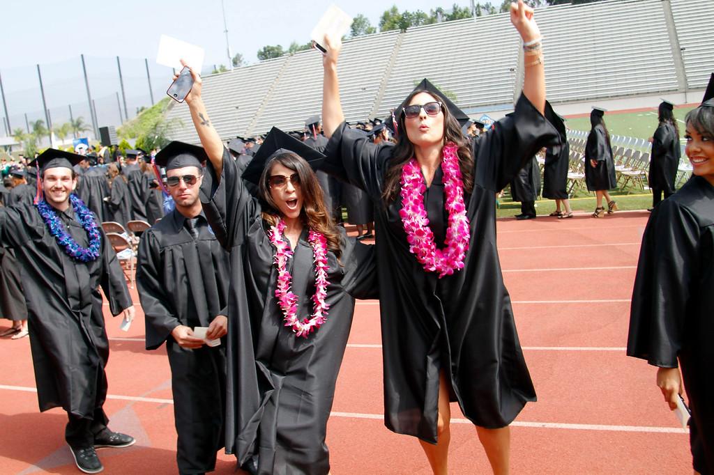Description of . Jubilant graduates during the Citrus College 97th Commencement Ceremony, at Citrus College Stadium, in Glendora, Saturday, June 15, 2013. (Correspondent Photo by James Carbone/SVCITY)