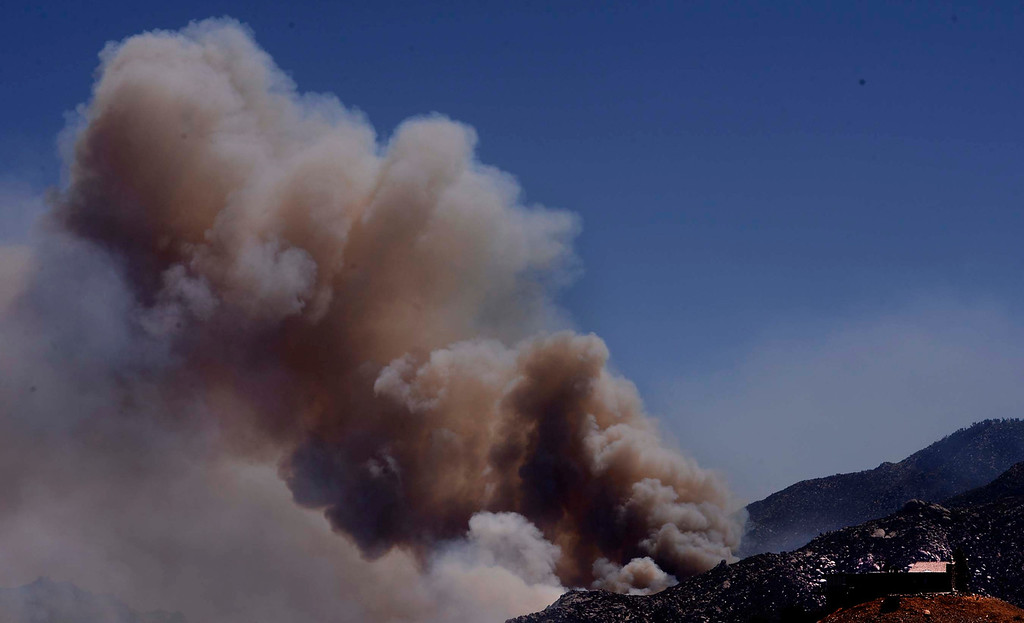 Description of . Smoke billows from the Silver Fire as seen from Twin Pines Road in the mountains south of Banning August 8, 2013.  GABRIEL LUIS ACOSTA/STAFF PHOTOGRAPHER.