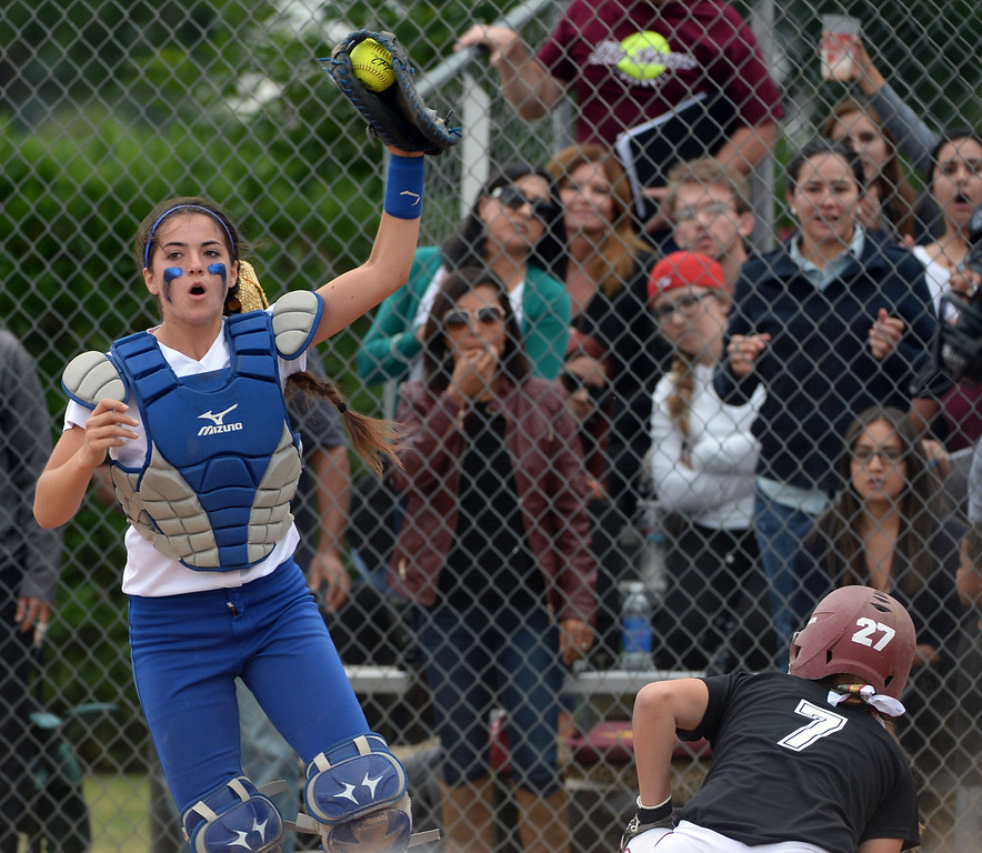Description of . La Serna's Liz Brautigam (7) scores past Bishop Amat catcher Julia Valenzuela in the second inning of a prep playoff softball game at Bishop Amat High School in La Puente, Calif., on Thursday, May 22, 2014. La Serna won 6-0.   (Keith Birmingham/Pasadena Star-News)