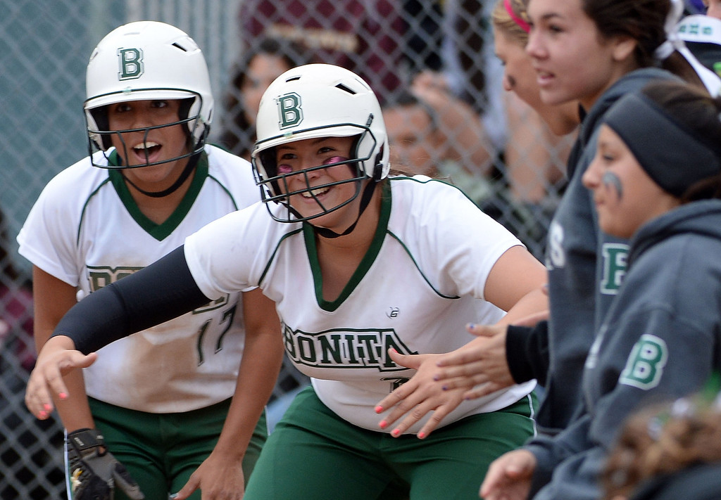Description of . Bonita teammates wait for Chloe Melanson (not pictured) at home plate after hitting a two run home run in the sixth inning of a prep softball game against West Covina at Los Flores Park in La Verne, Calif., on Thursday, March 27, 2014. Bonita won 6-3. (Keith Birmingham Pasadena Star-News)