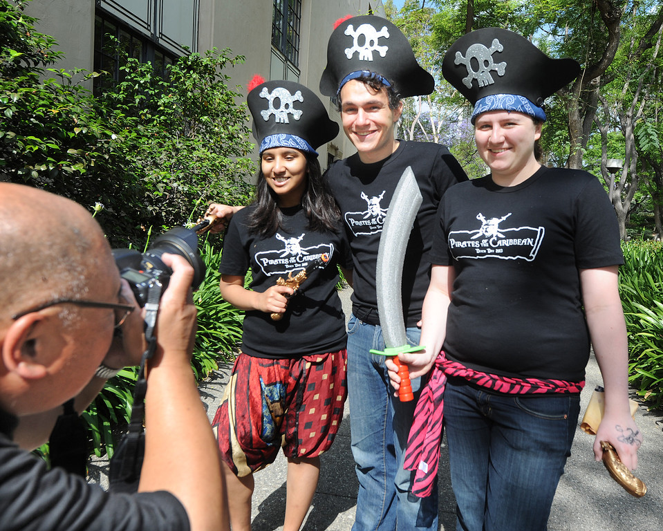 Description of . Caltech students Prastuti Singh, left, Jetson Leder-Luis, and Brooklyn Schlamp from Ricketts House pose for a photo for Robert Paz, dressed as Pirates of Caribean.  A fun-filled day of antics and escapades, Ditch Day is one of Caltech's oldest traditions – a cross between Animal House and a science fair! Friday, May 24, 2013. Caltech seniors ditch their classes while underclassmen devote their entire day to quirky pranks and attempting to solve elaborate puzzles, mazes, quests, and other challenging hijinks that seniors have devised and left behind for them.This year's activities include a laser maze, sledgehammer brick building demolition, shopping cart race, sumo tournament, roof rappelling, hovercraft human bowling, teleportation and time-travel puzzles, and much more.(SGVN/Photo by Walt Mancini)