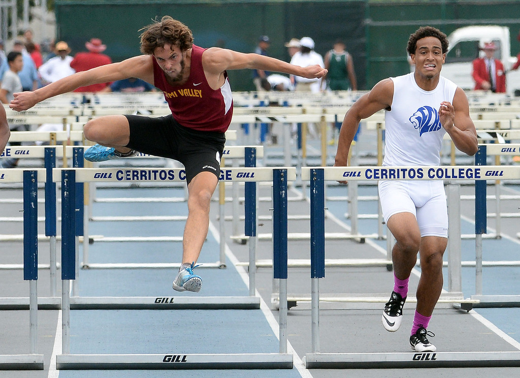 Description of . Simi Valley's Alex Billin, left, wins the division 2 110 meter high hurdles during the CIF Southern Section track and final Championships at Cerritos College in Norwalk, Calif., Saturday, May 24, 2014. 