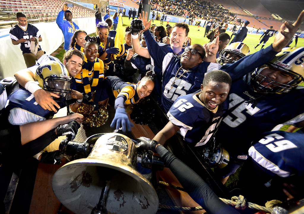 Description of . Muir rings the bell after defeating Pasadena 32-21 during the annual Turkey Tussle Friday night, November 8, 2013 at the Rose Bowl in Pasadena. (Photo by Sarah Reingewirtz/Pasadena Star-News)