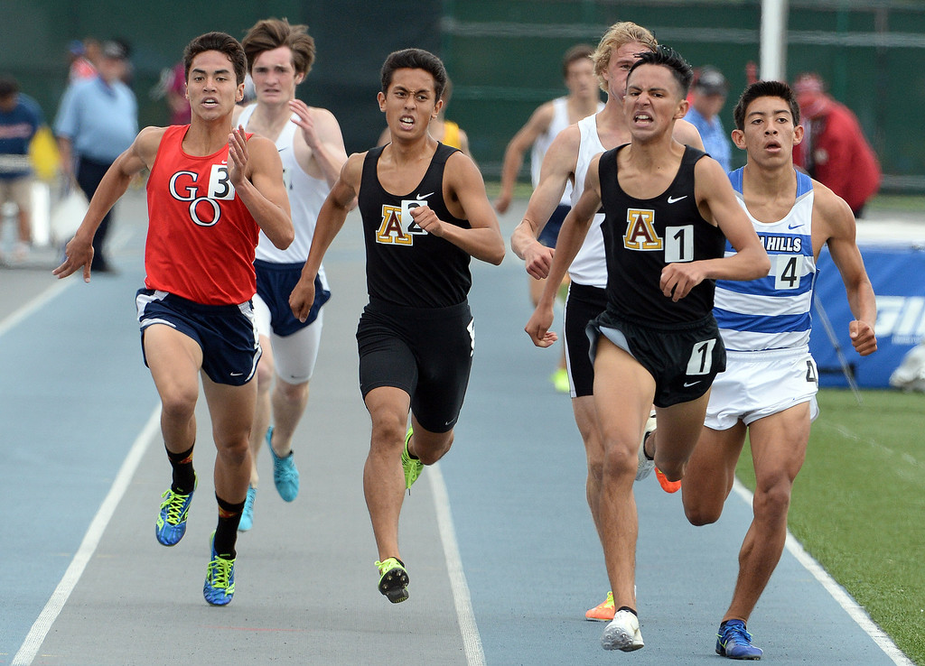 Description of . Arcadia's Estevan De La Rosa, right, wins the division 2 1600 meter run past teammate Phillip Rocha during the CIF Southern Section track and final Championships at Cerritos College in Norwalk, Calif., Saturday, May 24, 2014. 
