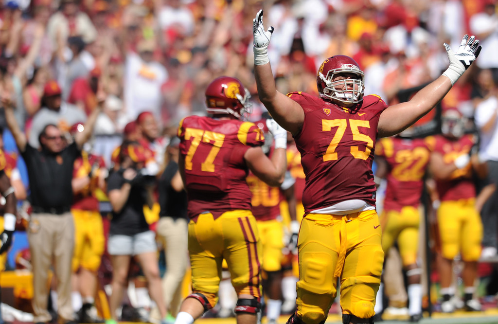 Description of . Max Tuerk is jubilant after a TD in the 3rd quarter. USC defeated Boston College 35-7 in a game played at the Coliseum in Los Angeles, CA. 9/14/2013. photo by (John McCoy/Los Angeles Daily News)