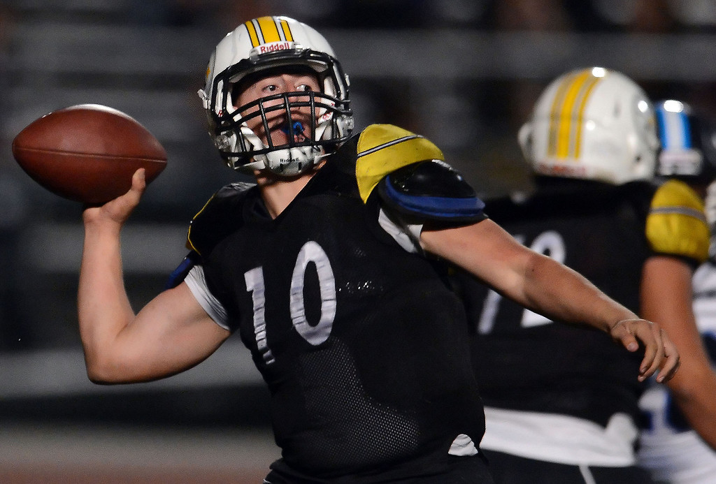 Description of . Bassett quarterback Nicolas Colmenero (10) passes against Duarte in the first half of a prep football game at Bassett High School in La Puente, Calif., on Friday, Nov. 1, 2013.    (Keith Birmingham Pasadena Star-News)