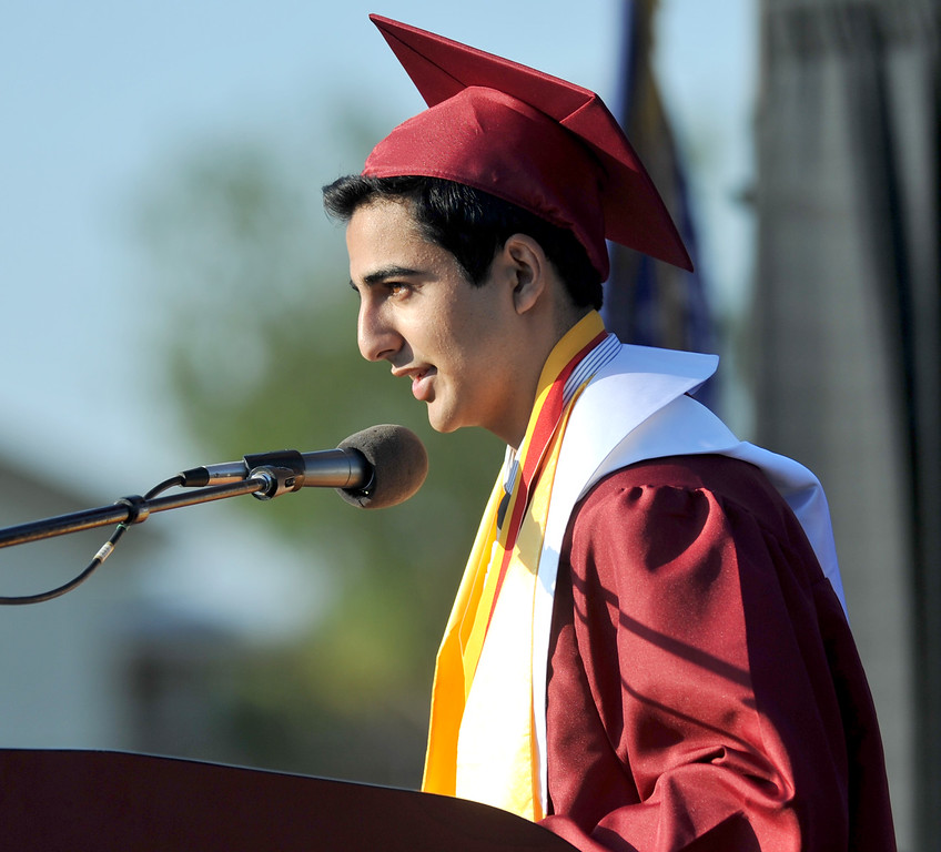 Description of . Seniors receive their diplomas during La Serna High School's 51st Annual Commencement at La Mirada High School stadium in La Mirada on Thursday June 13, 2013. La Serna marked the commencement of 635 graduates and marking Principal Ann Fitzgerald's first graduation as principal. (SGVN/Staff Photo by Keith Durflinger)