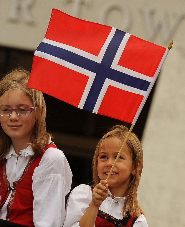 Description of . Brita Amine Hendrickson, 7, waves a Norwegian flag during the Sons of Norway's Celebration of Norway's Constitution Day in downtown San Bernardino May 17, 2013.  GABRIEL LUIS ACOSTA/STAFF PHOTOGRAPHER.
