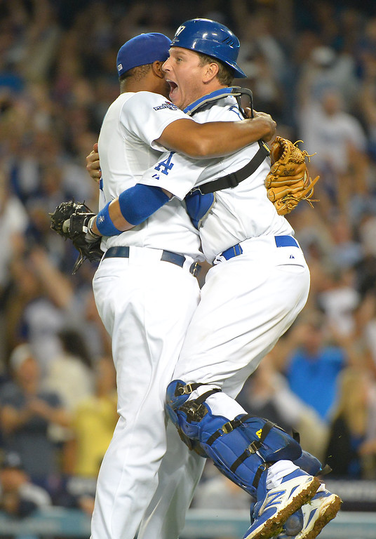 Description of . A.J Ellis and Kenley Jansen celebrate after defeating the Braves Monday, October 7, 2013 ( Photo by Andy Holzman/Los Angeles Daily News )