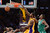 Lakers Earl Clark slams in two as Celtics' Jeff Green defends during first half action at Staples Wednesday.  Photo by David Crane/Staff Photographer