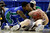Florida Gulf Coast's Dajuan Graf, left, struggles for a loose ball with Georgetown's Nate Lubick during the first half of a second-round game of the NCAA college basketball tournament on Friday, March 22, 2013, in Philadelphia. (AP Photo/Matt Rourke)