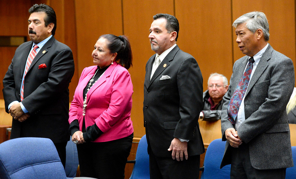 Description of . Irwindale officials, from left, Councilman Manuel Garcia, former Councilwoman Rosemary Ramirez, Mayor Mark Breceda and Abe De Dios, retired finance director, appear in court for the fifth time Tuesday, December 17, 2013 at Clara Shortridge Foltz Criminal Justice Center in Los Angeles as attorneys argue statue of limitations on conflict of interest and misappropriation of public funds' charges. (Photo by Sarah Reingewirtz/Pasadena Star-News)