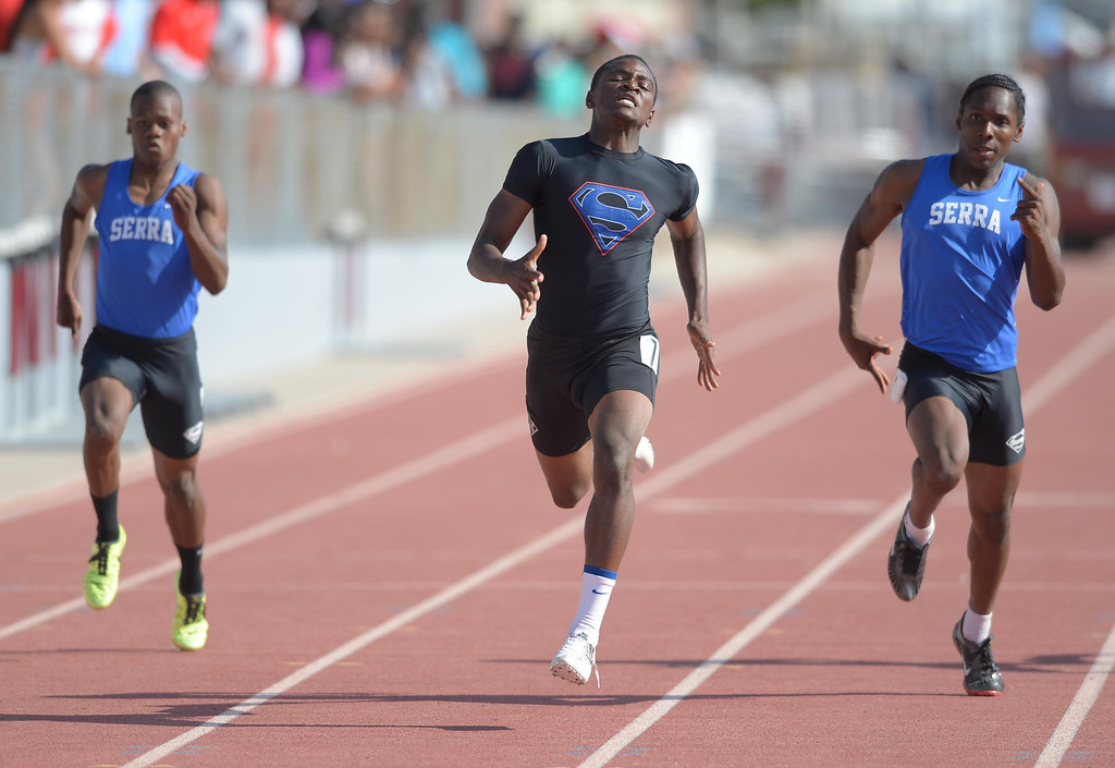 Description of . Serra's Darrell Fuery, center, wins  the 200 meter Division 4 race of the CIF Southern Section Track and Field Championships over teammates Adoree Jackson, right, (second) and Ronny Hall, left, Saturday at Mt. SAC. 20130518 Photo by Steve McCrank / Staff Photographer